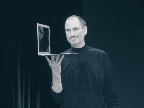 Steve Jobs holding MacBook Air