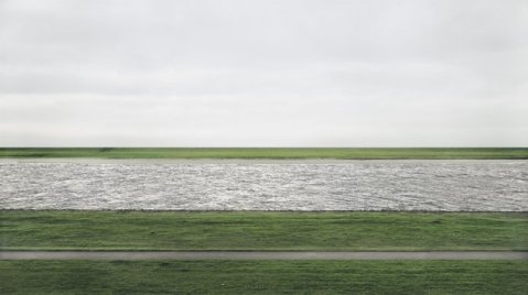 "This 1999 photograph provided by Chrisitie's shows the Rhine river by German artist Andreas Gursky. Titled ""Rhein II,"" the chromogenic color print face-mounted to acrylic glass was sold for $4.3 million Tuesday, Nov. 8, 2011, at Christie's in New York City, setting a record for any photograph sold at auction. (AP Photo/Christie's, Andreas Gursky)"
